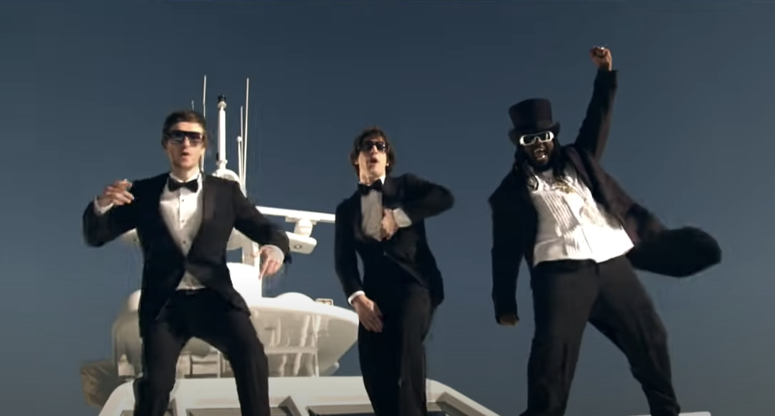 T-Pain and the Lonely Island singing in tuxes on a boat