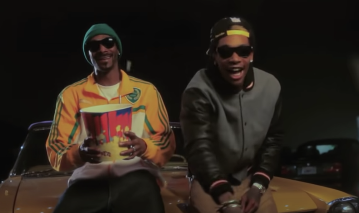 Snoop and Wiz on a car's hood with popcorn