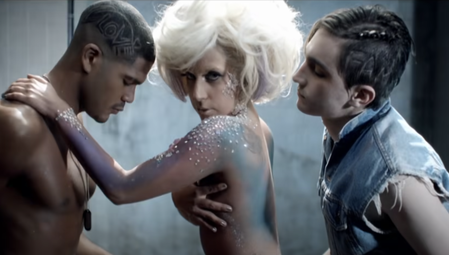 Lady Gaga naked in glitter between two men