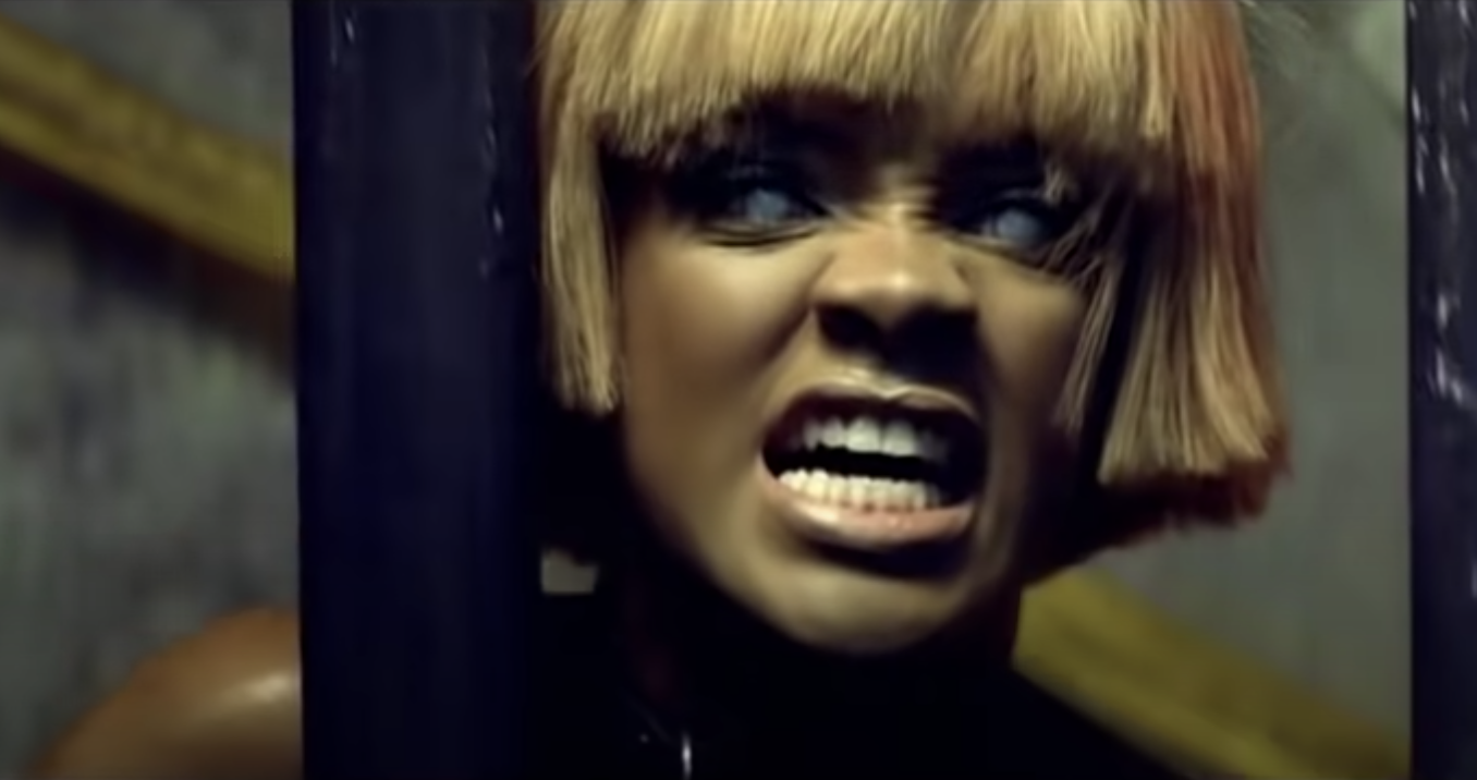 Rihanna with creepy contacts growling out of a cage