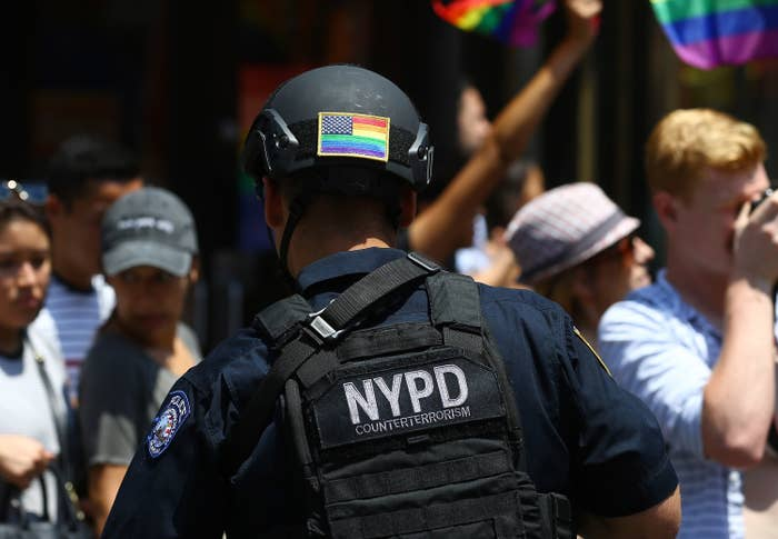 NYPD officer with a pride flag on the back of their helmet