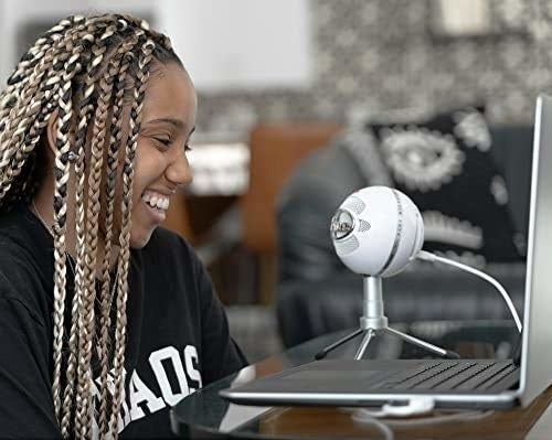 A person using the cardioid condenser mic connected to their laptop.