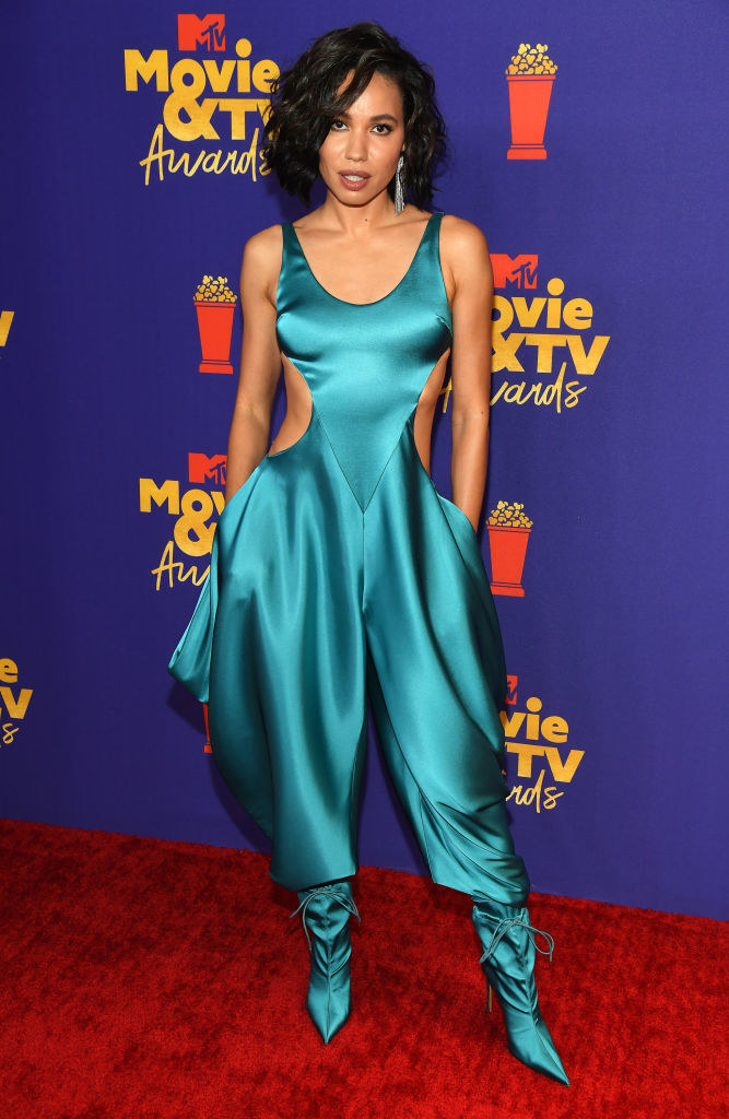 Jurnee wore a satin jumpsuit with matching boots