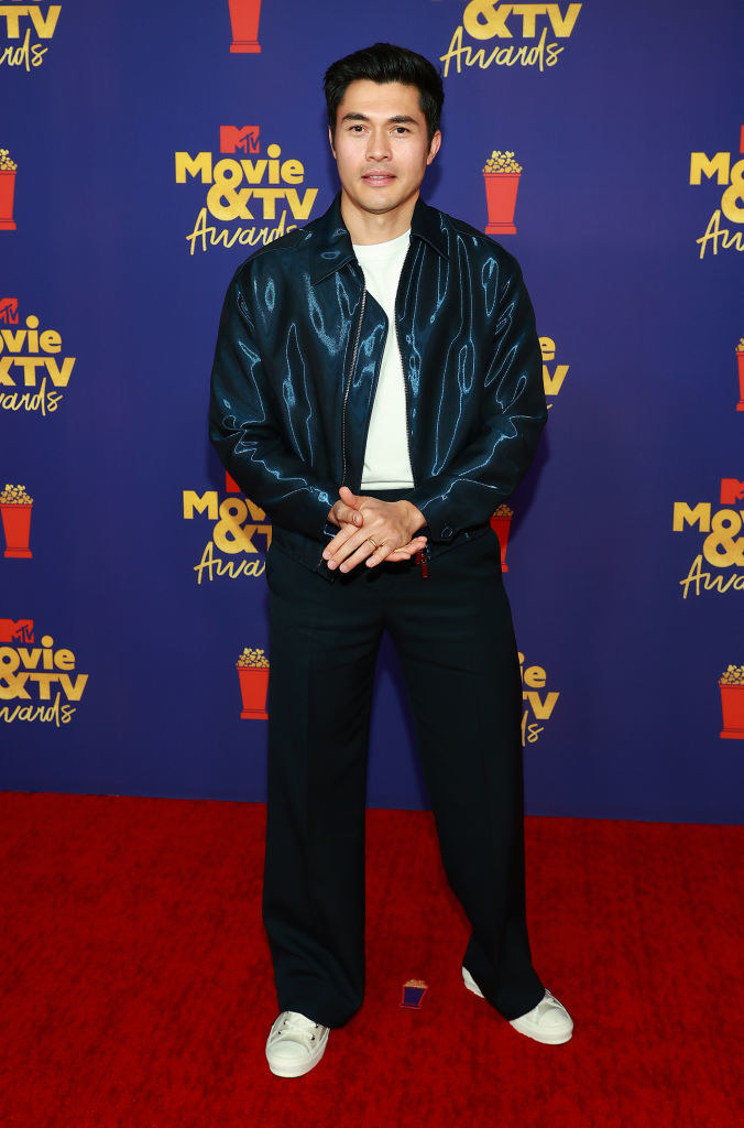Henry wore slacks and a metallic colored jacket