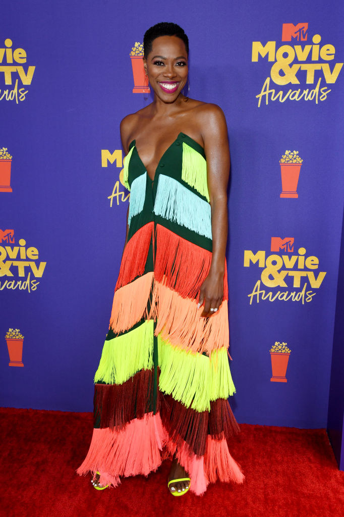 Yvonne in a multicolored strapless fringe dress