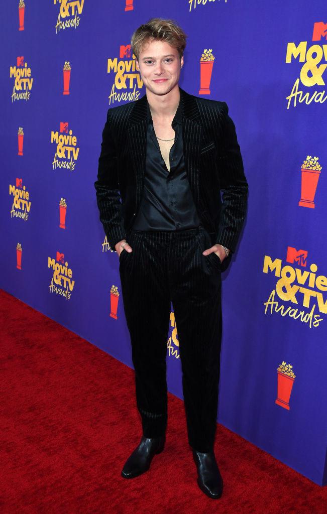 Rudy in a dark suit