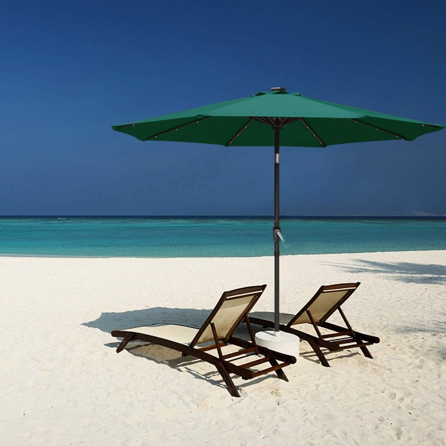 The umbrella over two patio chairs at a beach