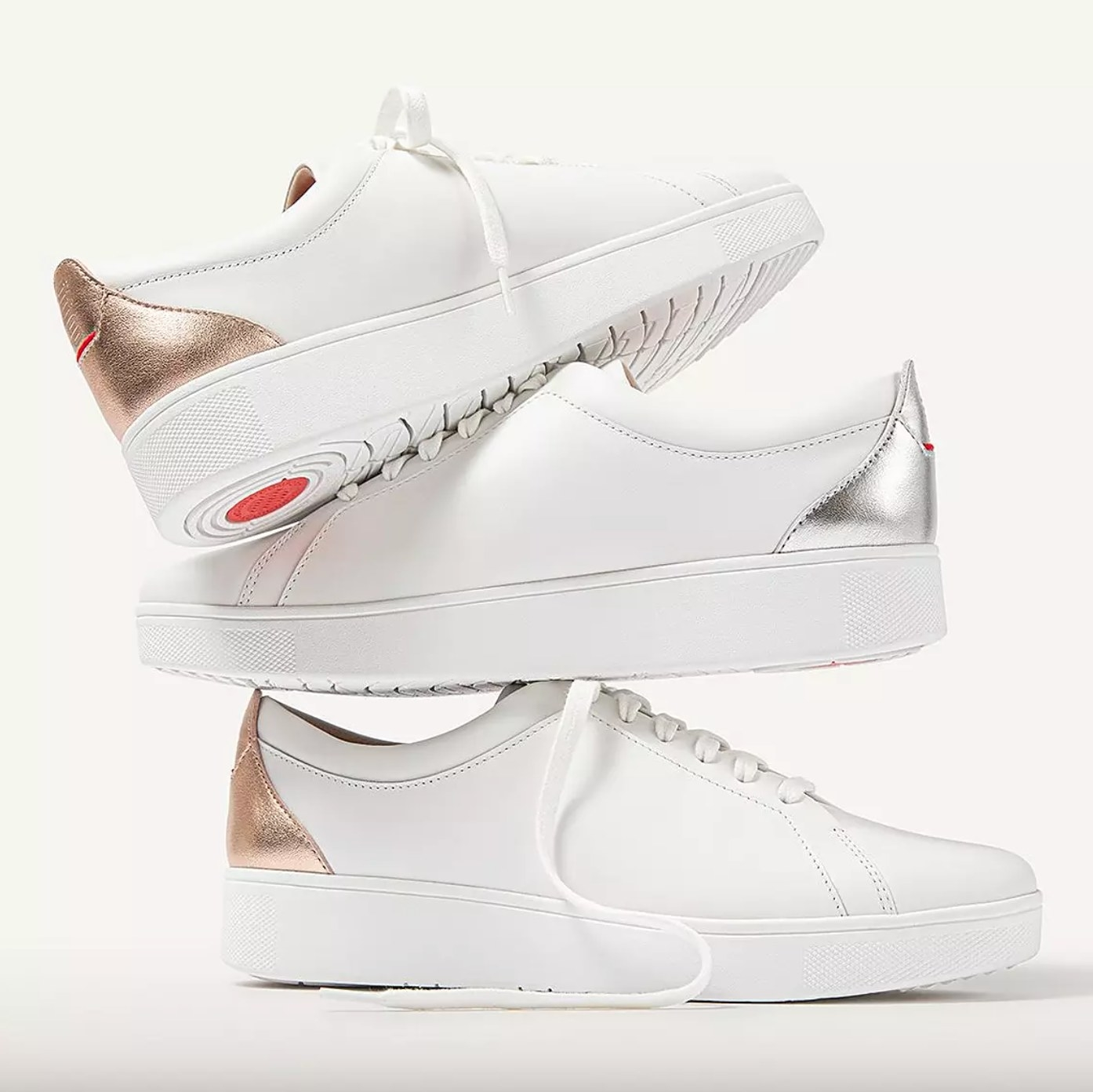 The pair of metallic backtab leather sneakers in rose gold
