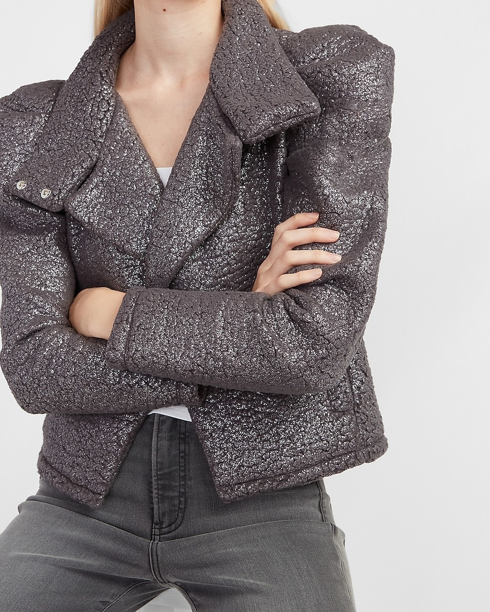 model wearing a sparkly puff-sleeve sherpa jacket