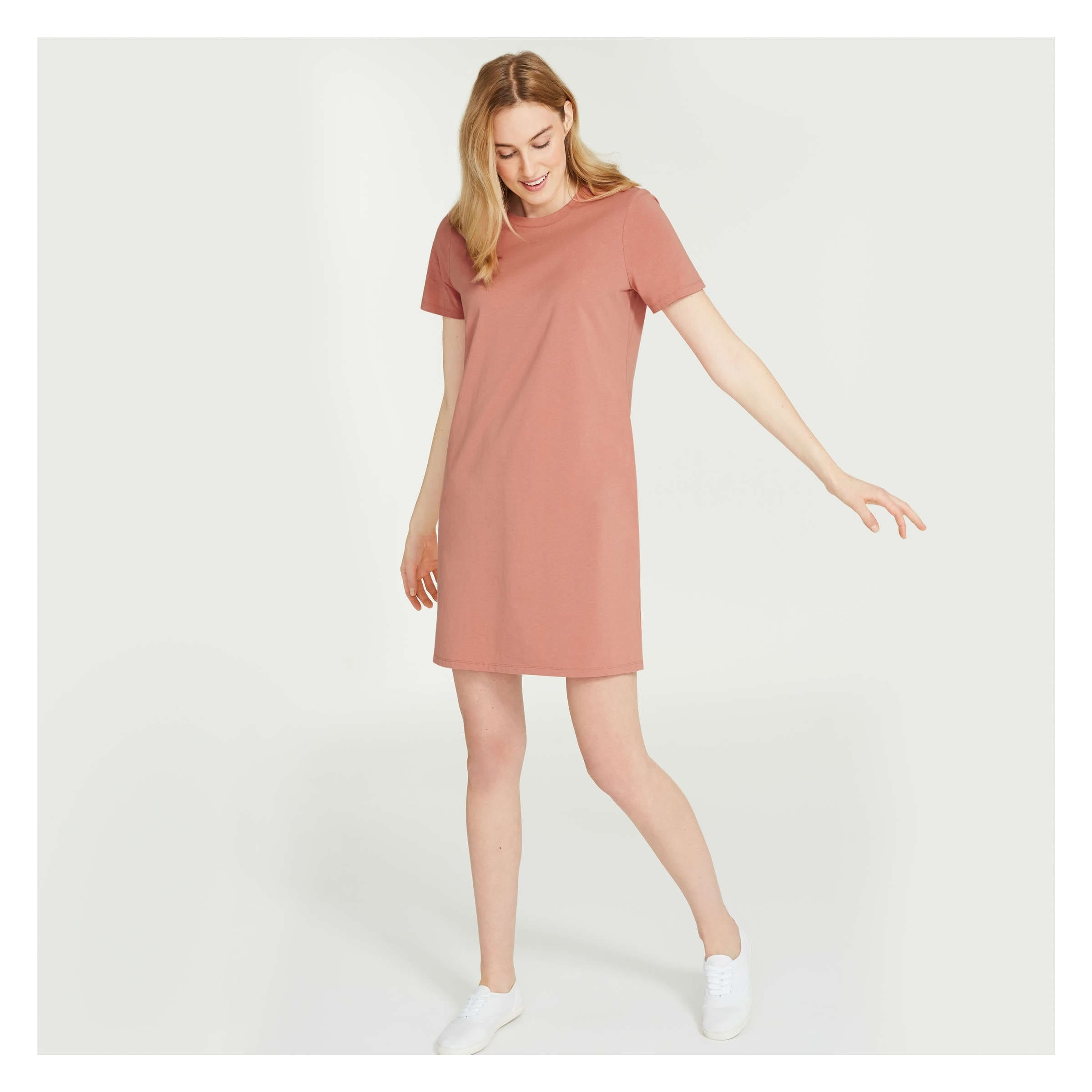 A person wearing the t-shirt dress
