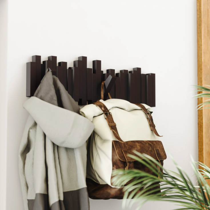 A bag and jacket hanging from the rack