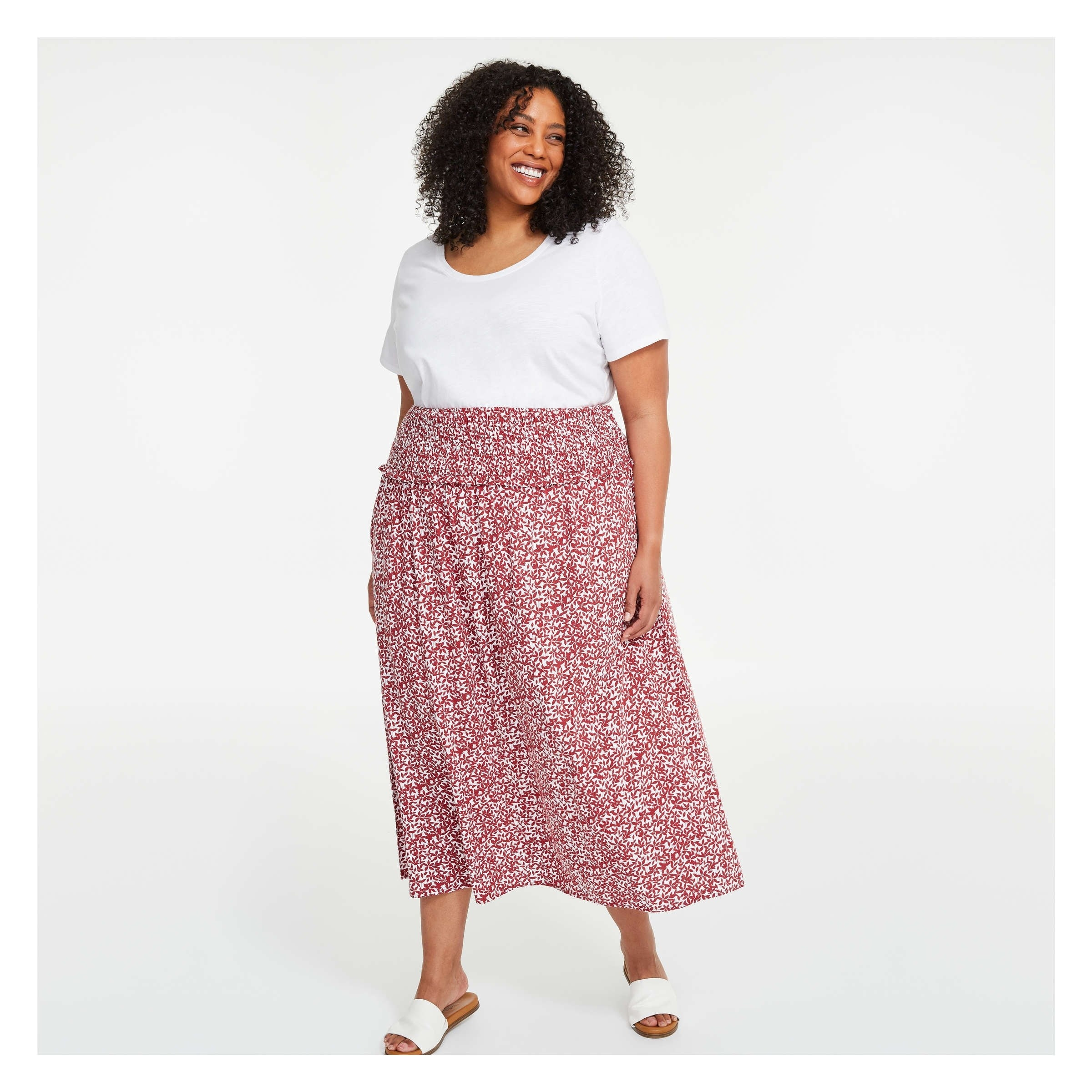 a person wearing a long floral skirt