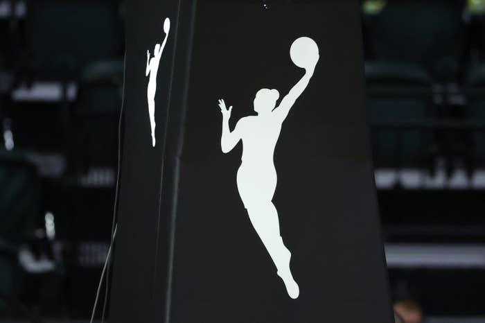 WNBA logo of a woman shooting basketball