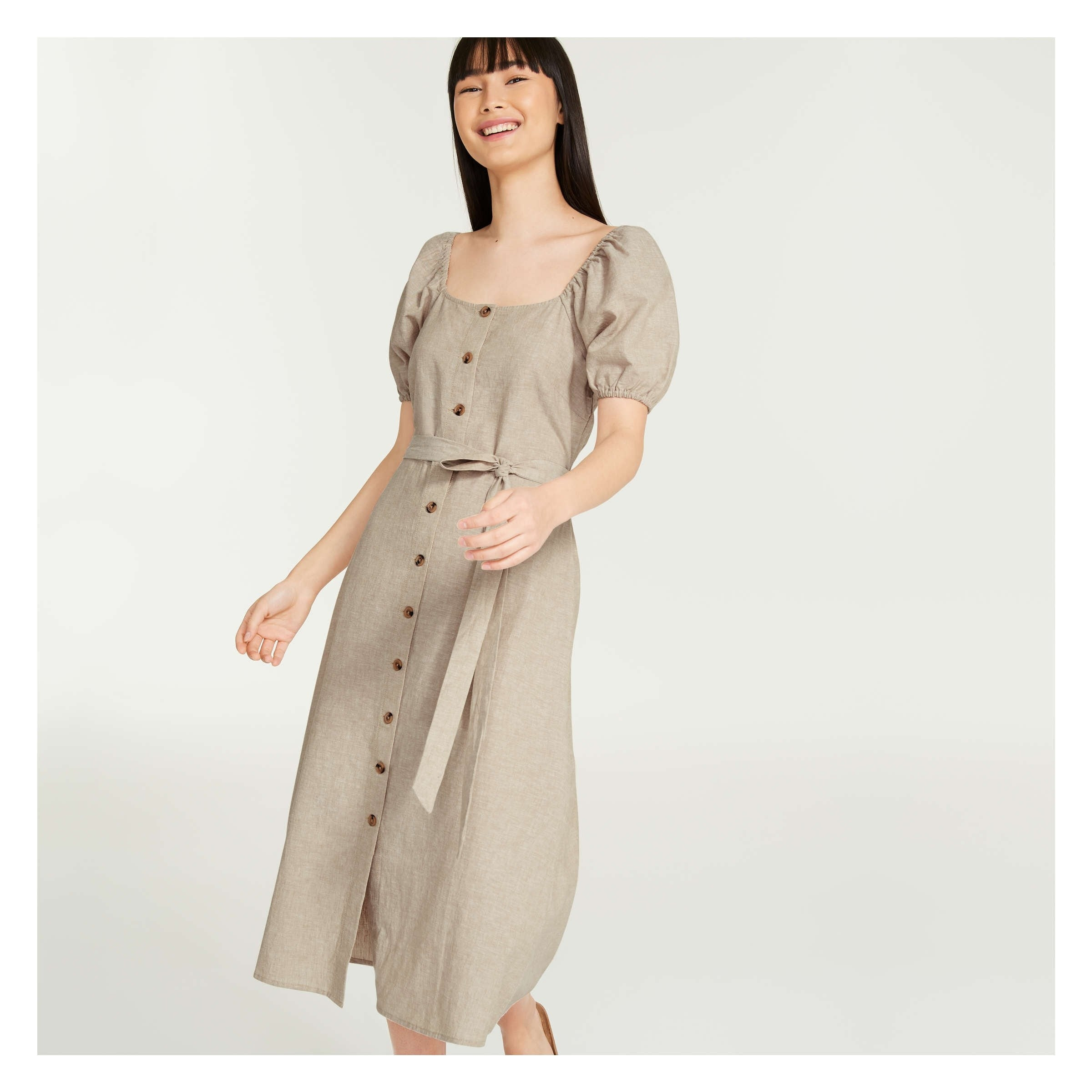 A person wearing the puff-sleeved button-up dress
