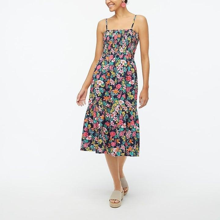 model wearing floral midi tank dress in floral print