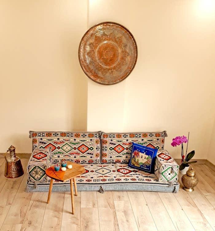 Turkish floor couch on wooden floor next to table