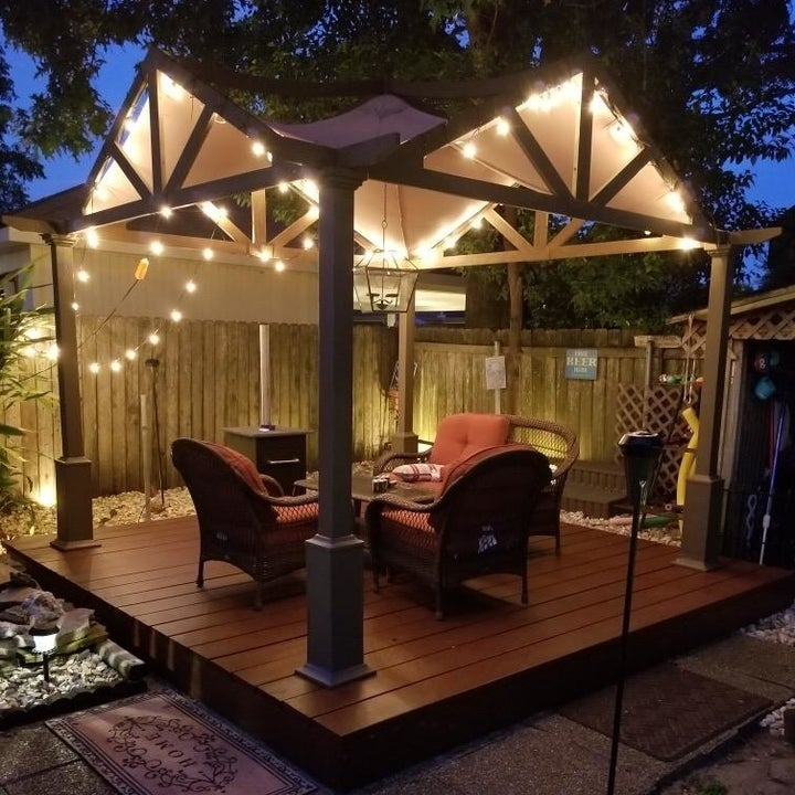 a reviewer photo of an outdoor gazebo with string lights along the edges
