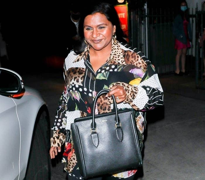 A smiling Mindy Kaling is in good spirits after grabbing a bite at Giorgio Baldi in Santa Monica