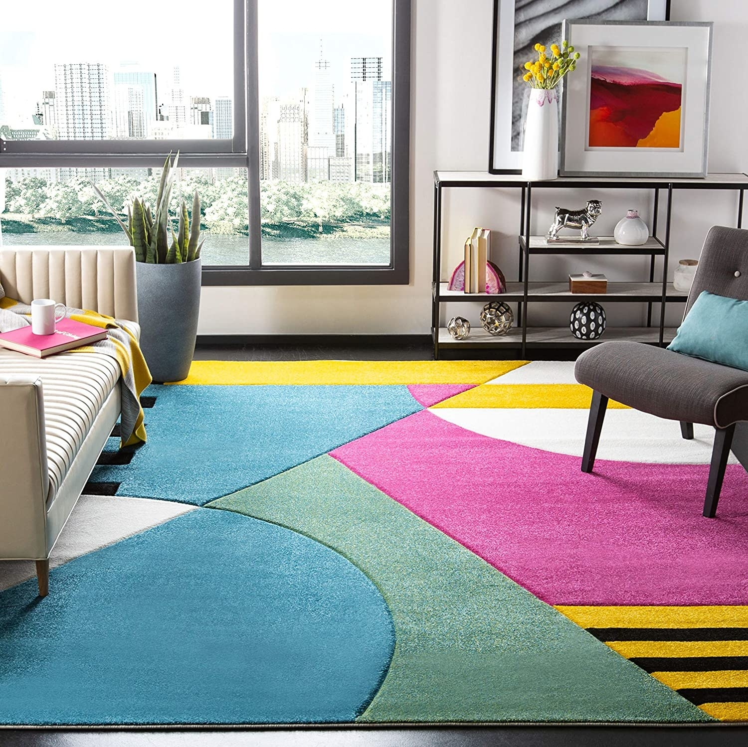 the bold area rug with colors that include blue green yellow black and pink in an abstract design