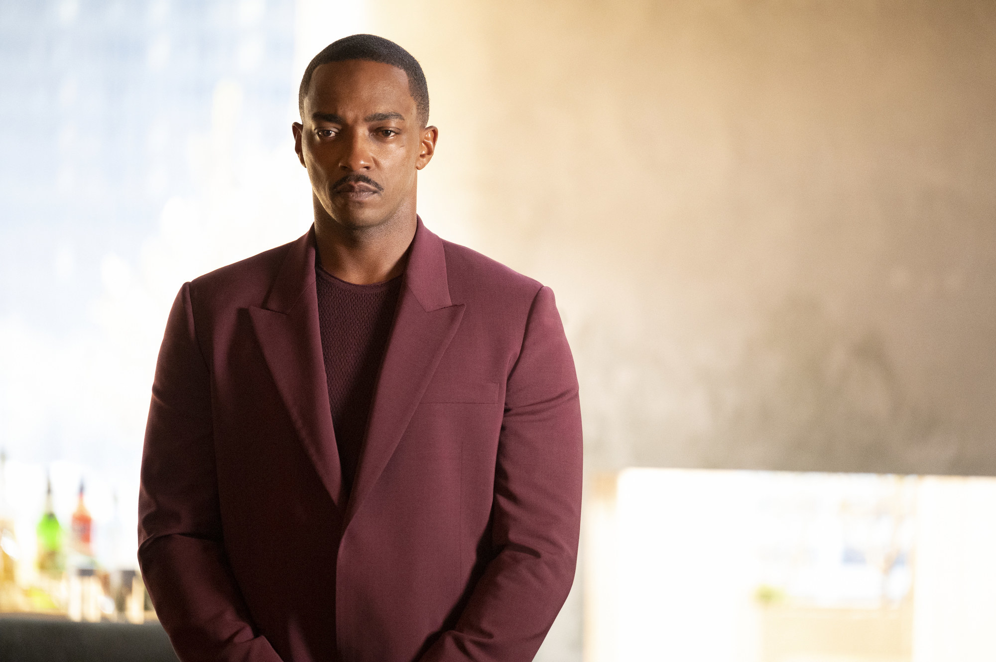 Anthony Mackie standing stoically in a scene from Solos