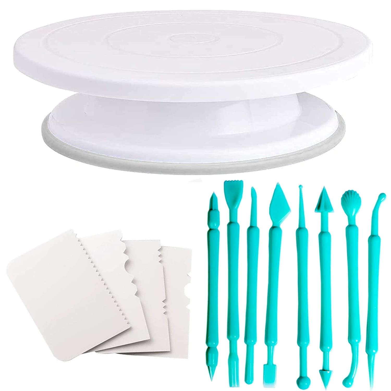 A white cake rotating stand, a set of four cake side scrapers with different edge designs and a set of blue fondant tools