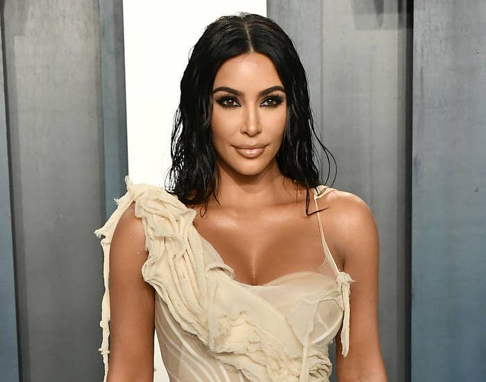 Kim wears a one-shoulder dress to an event