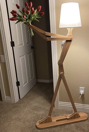 Reviewer's lamp holds a bouquet of red tulips