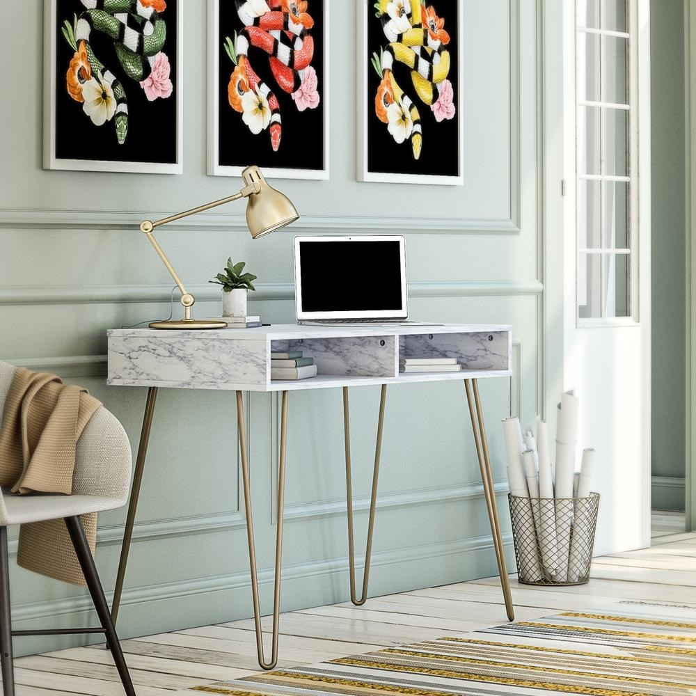 the white marble desk with gold legs