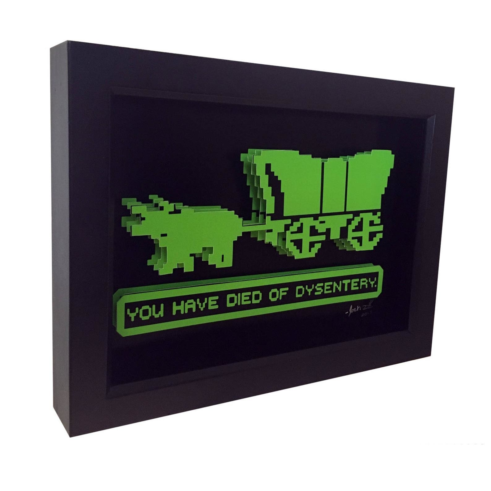 """A framed picture of an 8-bit covered wagon that says """"you have died of dysentery"""""""