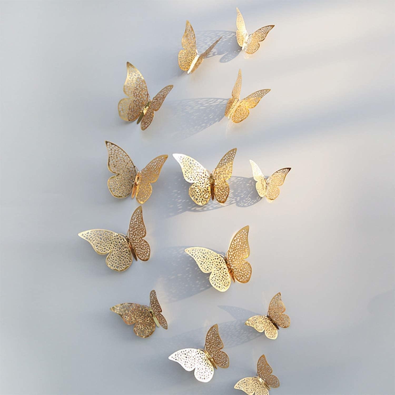 Golden butterflies arranged in a pattern on a wall.