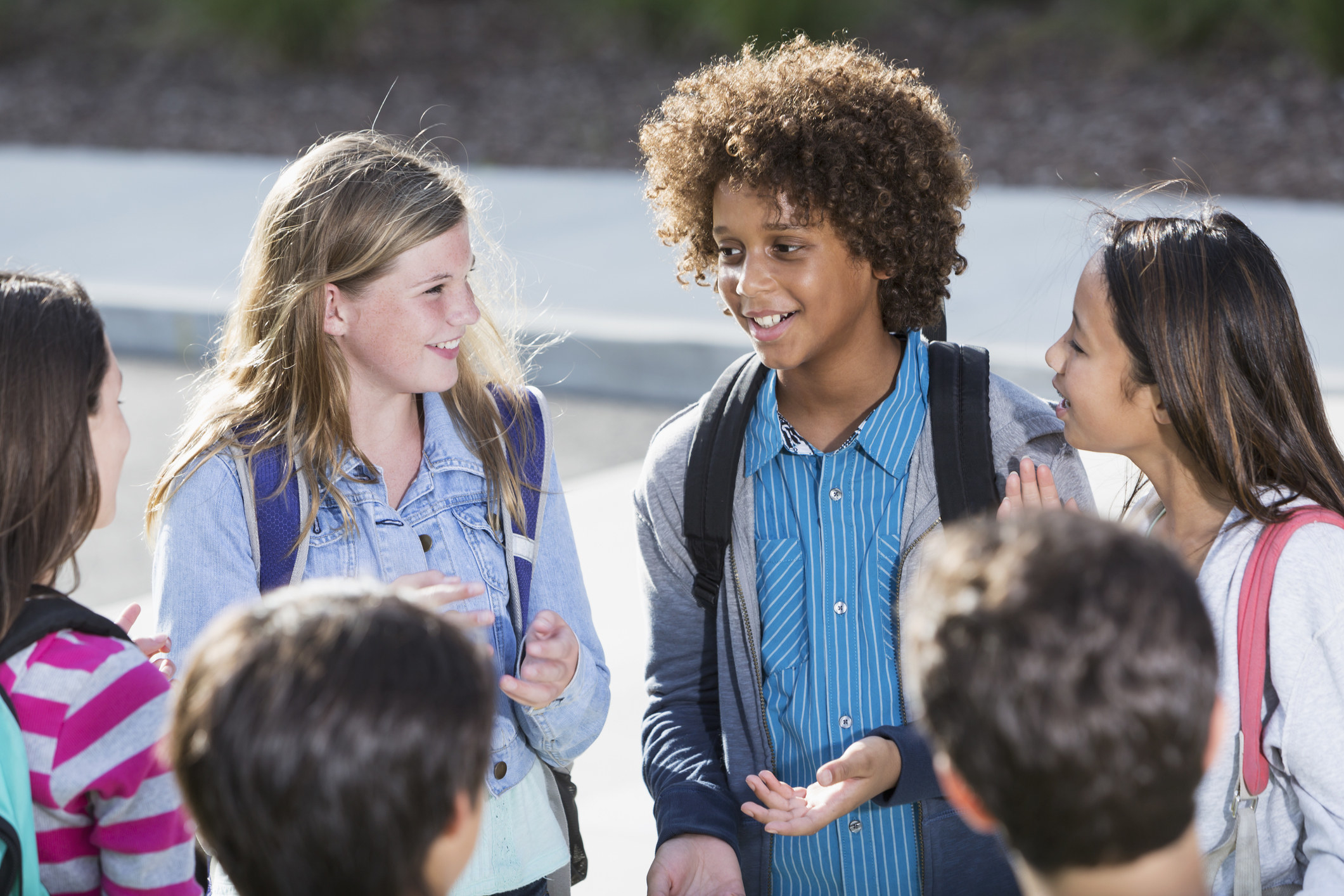 Students standing in a circle talking outdoors