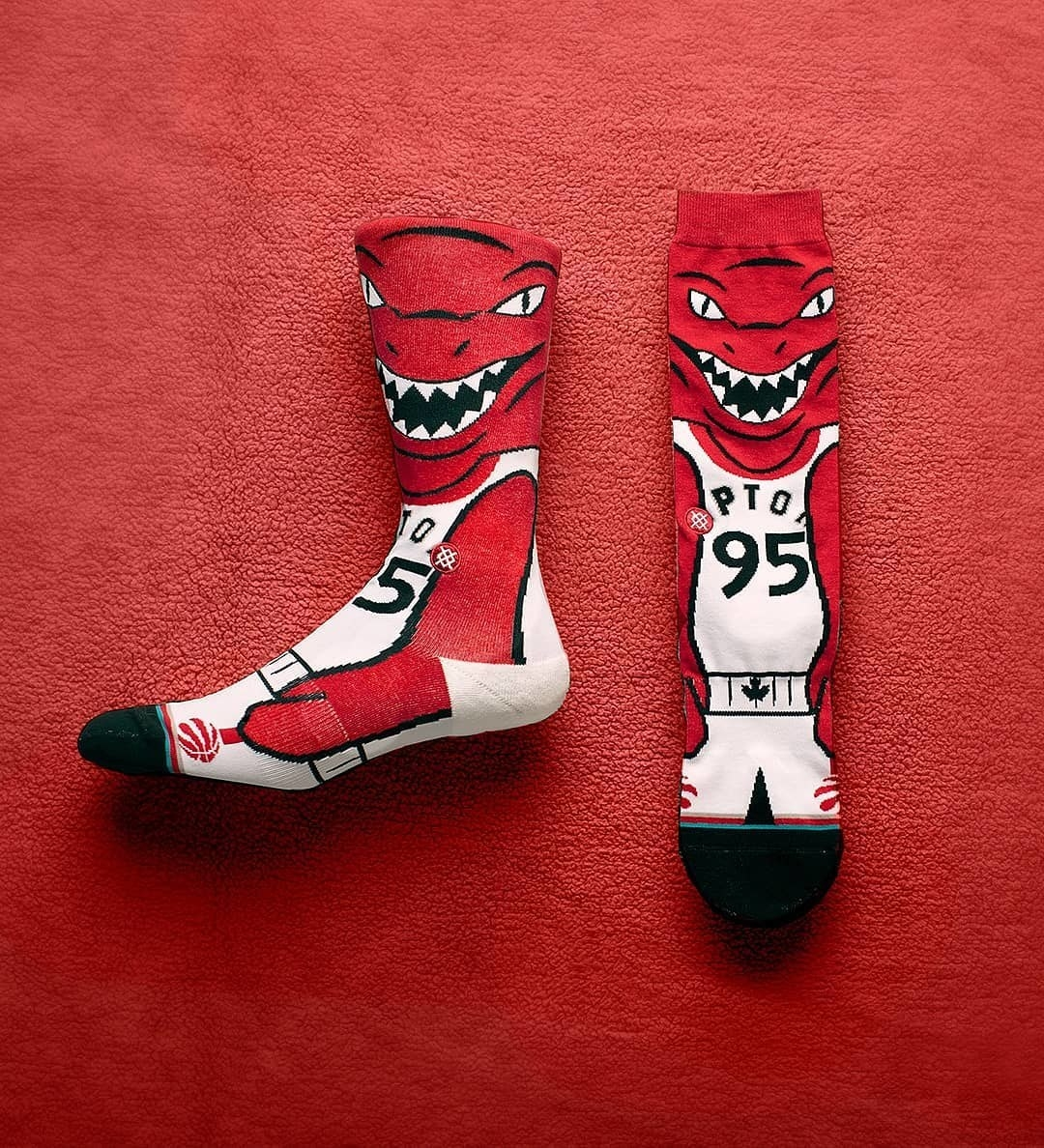 A pair of socks with an illustration of the NBA raptors