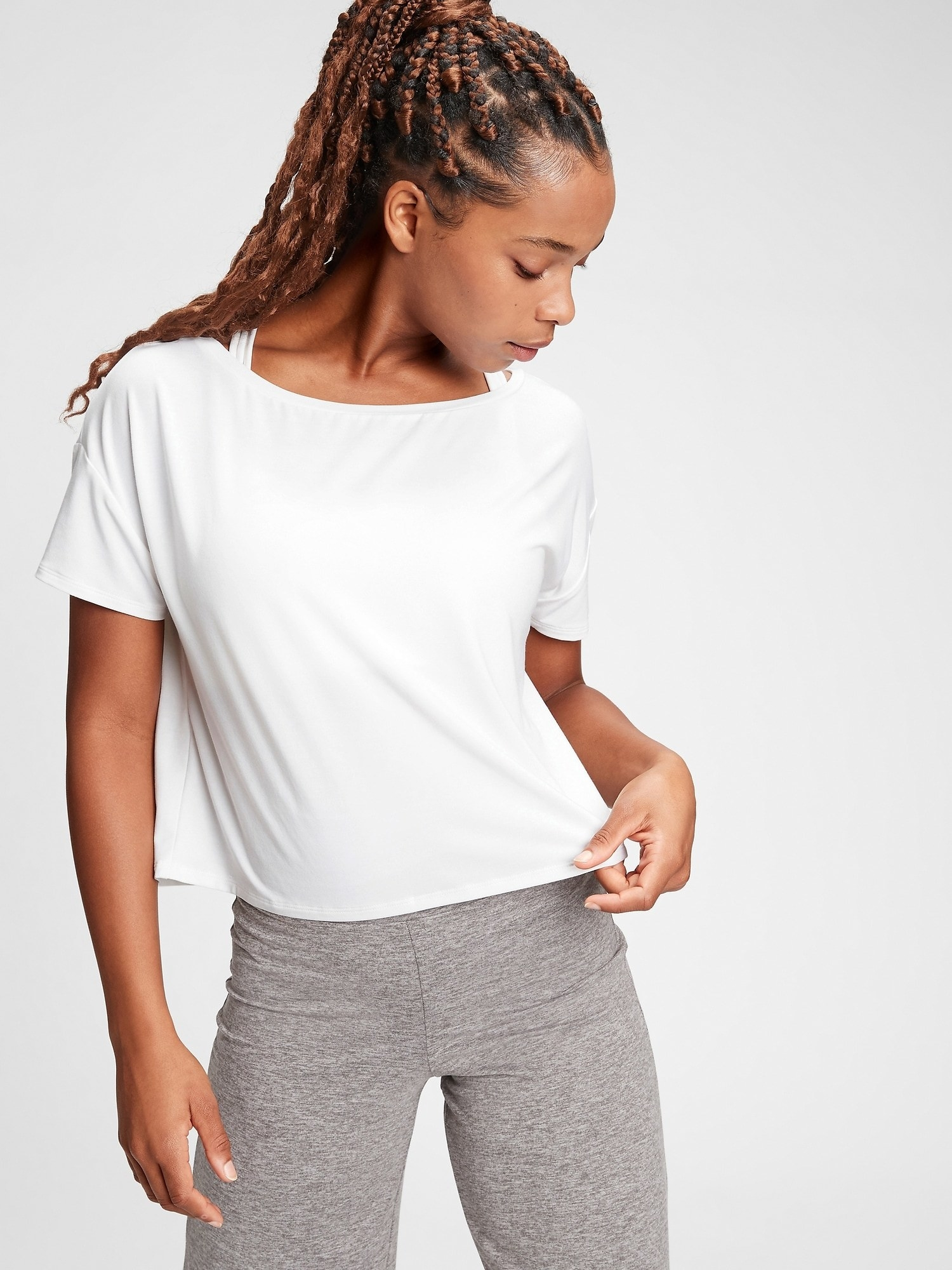 A person wearing the GAPfit t-shirt with a pair of leggings