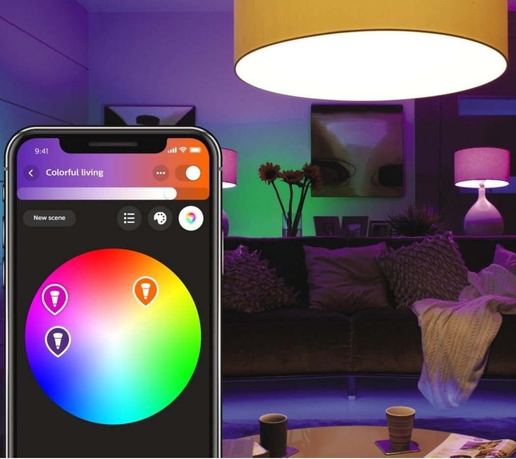 A phone adjusting the colours of the lights in a home