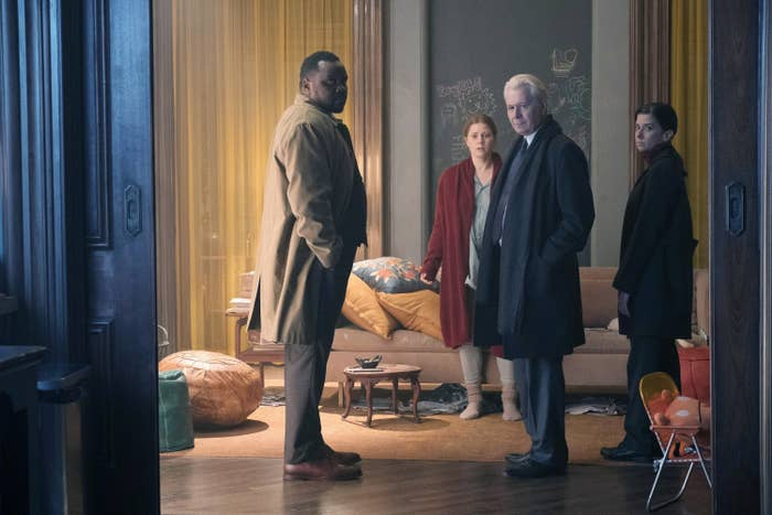 Detective Little, Anna, Alistair, and Detective Norelli in Anna's living room