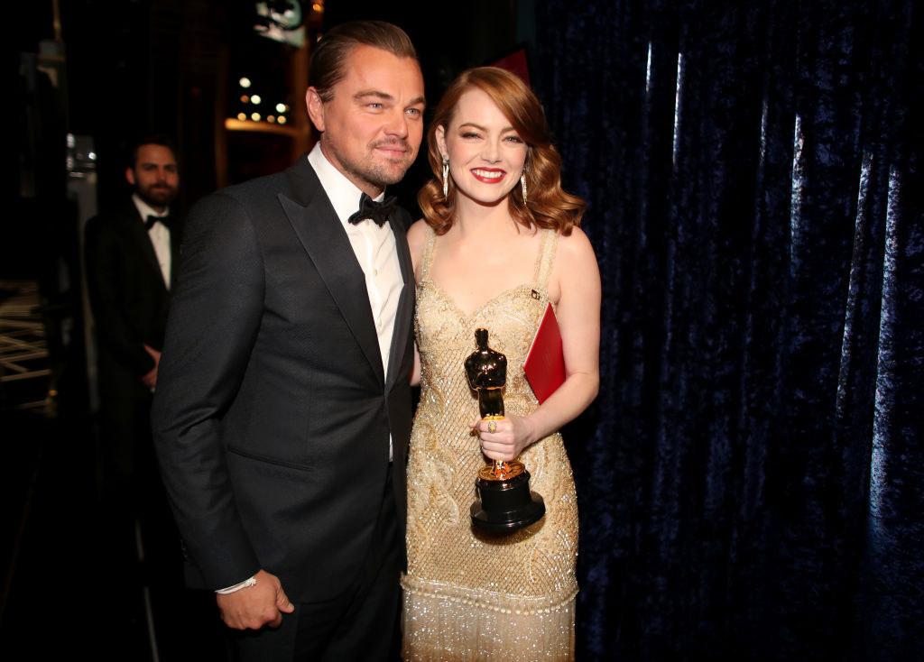 Leonardo DiCaprio and Emma Stone posing together at the 2017 Oscars