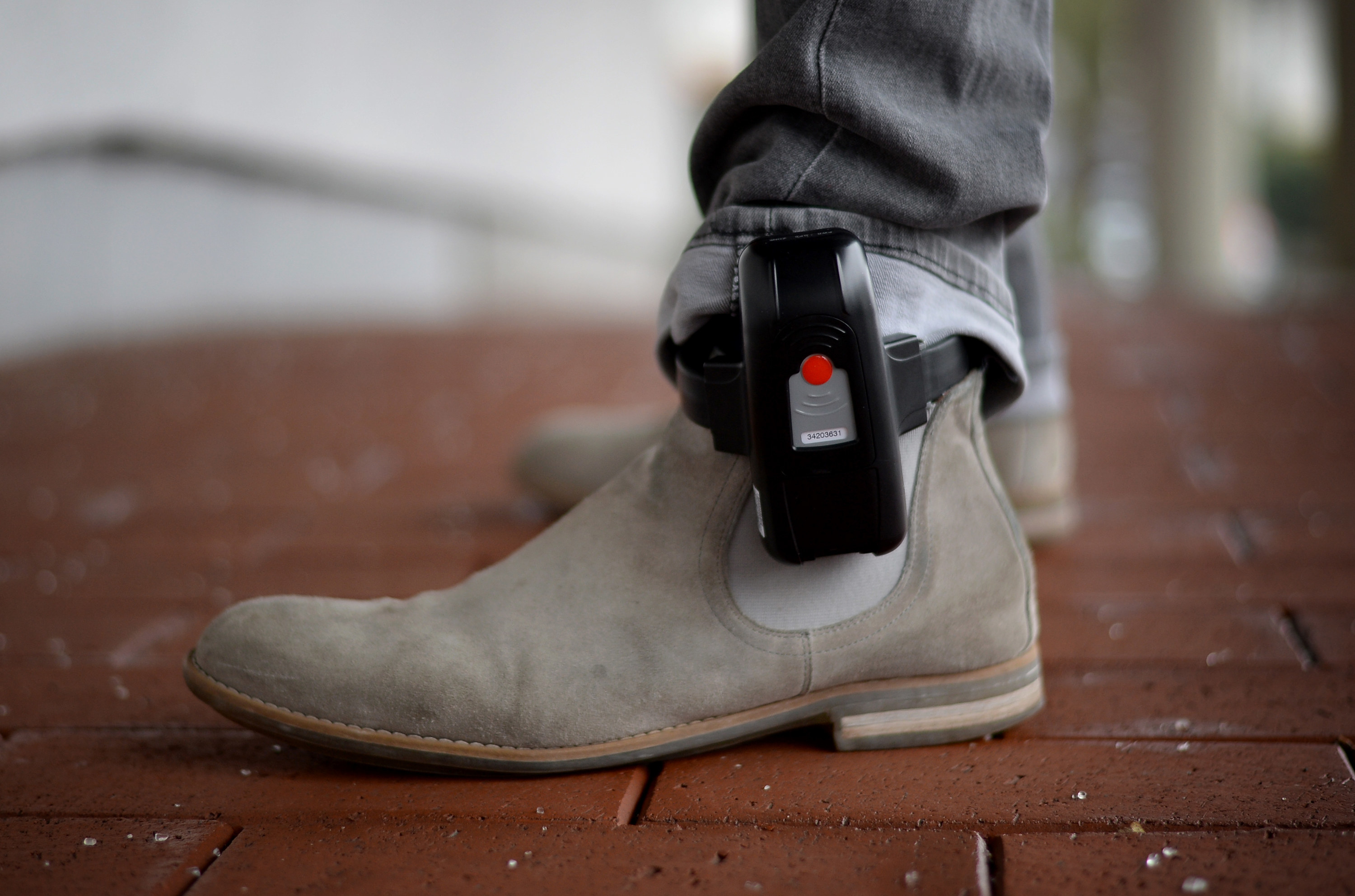 An ankle monitor on someone's foot