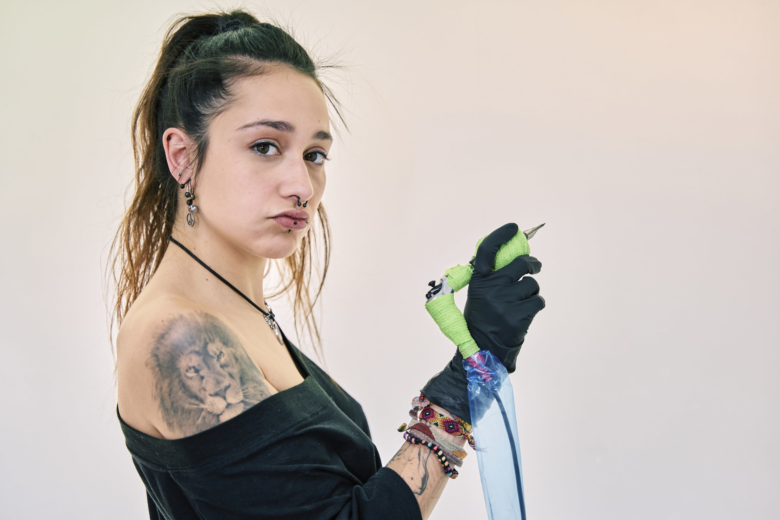 A person holding a tattoo needle