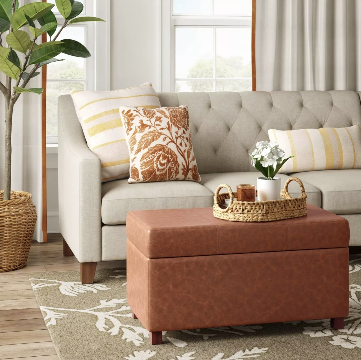 The ottoman is made of caramel faux leather and is a rectangular shape