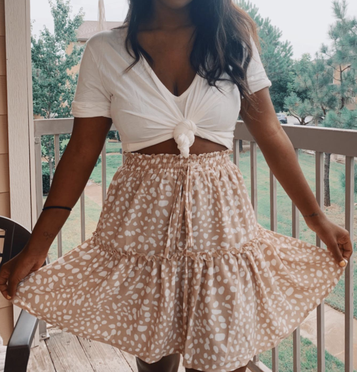 reviewer wearing the dotted skirt
