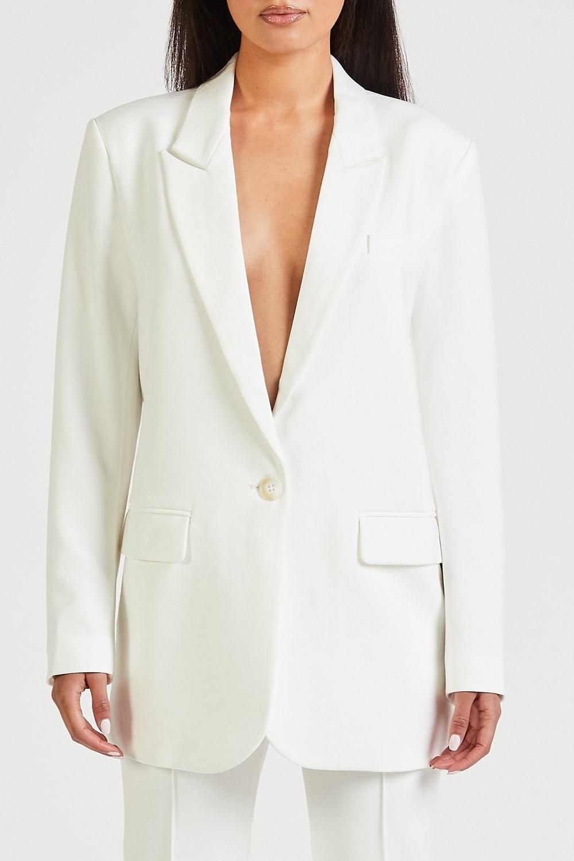 model wearing white blazer