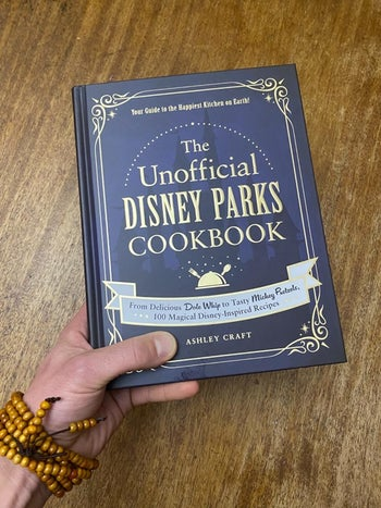 a reviewer holding the cook book