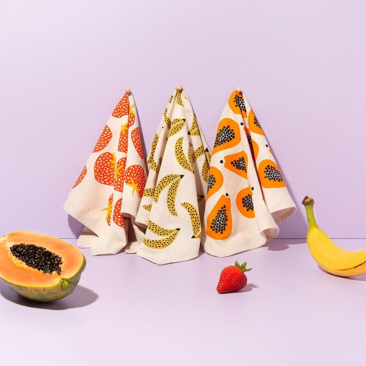 The tea towels in strawberry, banana, and papaya patterns
