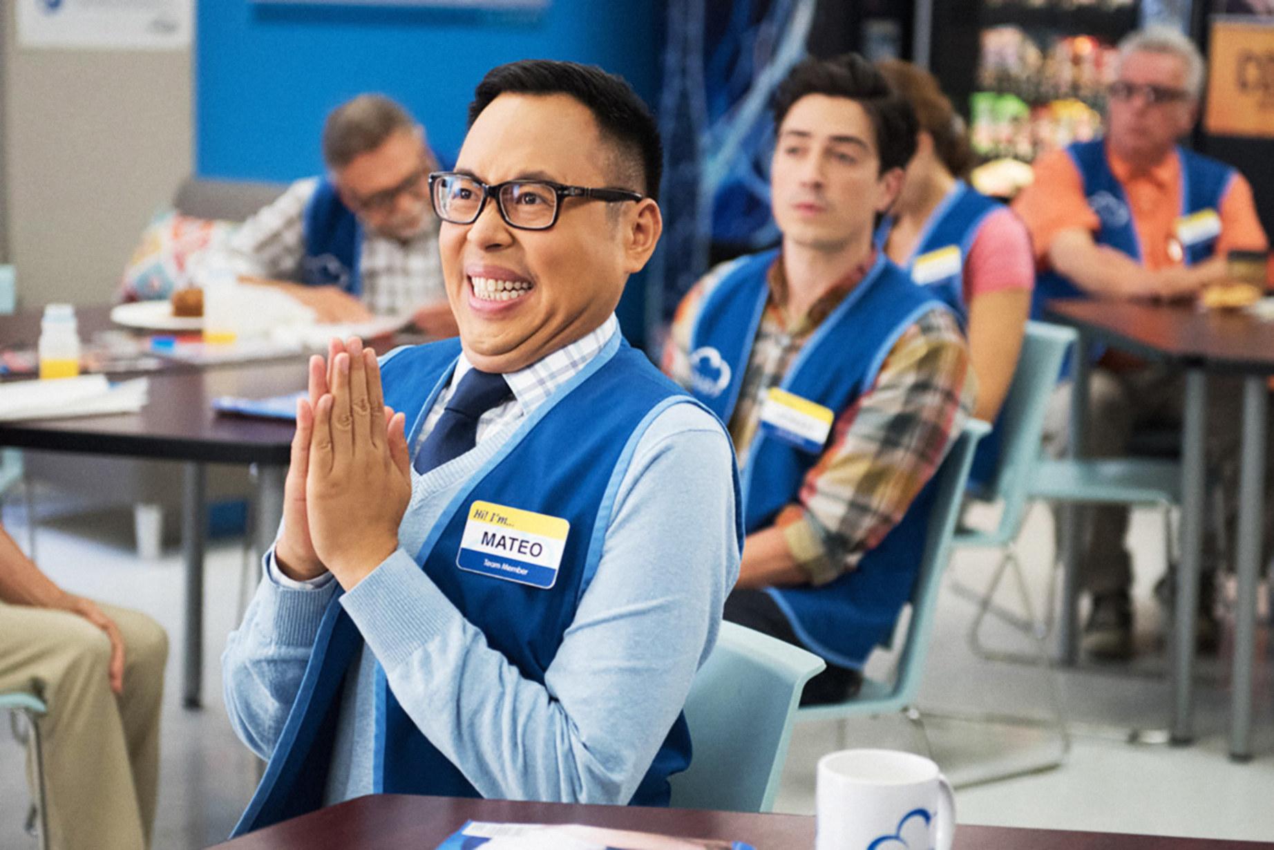 Nico Santos claps in the breakroom