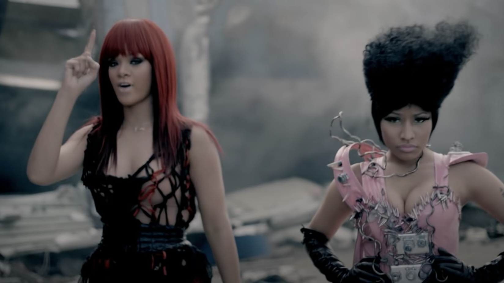 Rihanna and Nicki walking through wreckage
