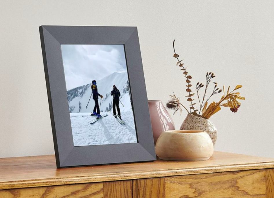 Picture frame showing image. It is on a desk.