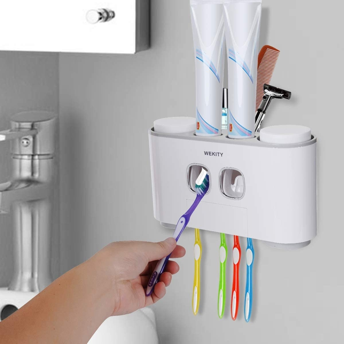 Model holding toothbrush up to automatic toothpaste dispenser