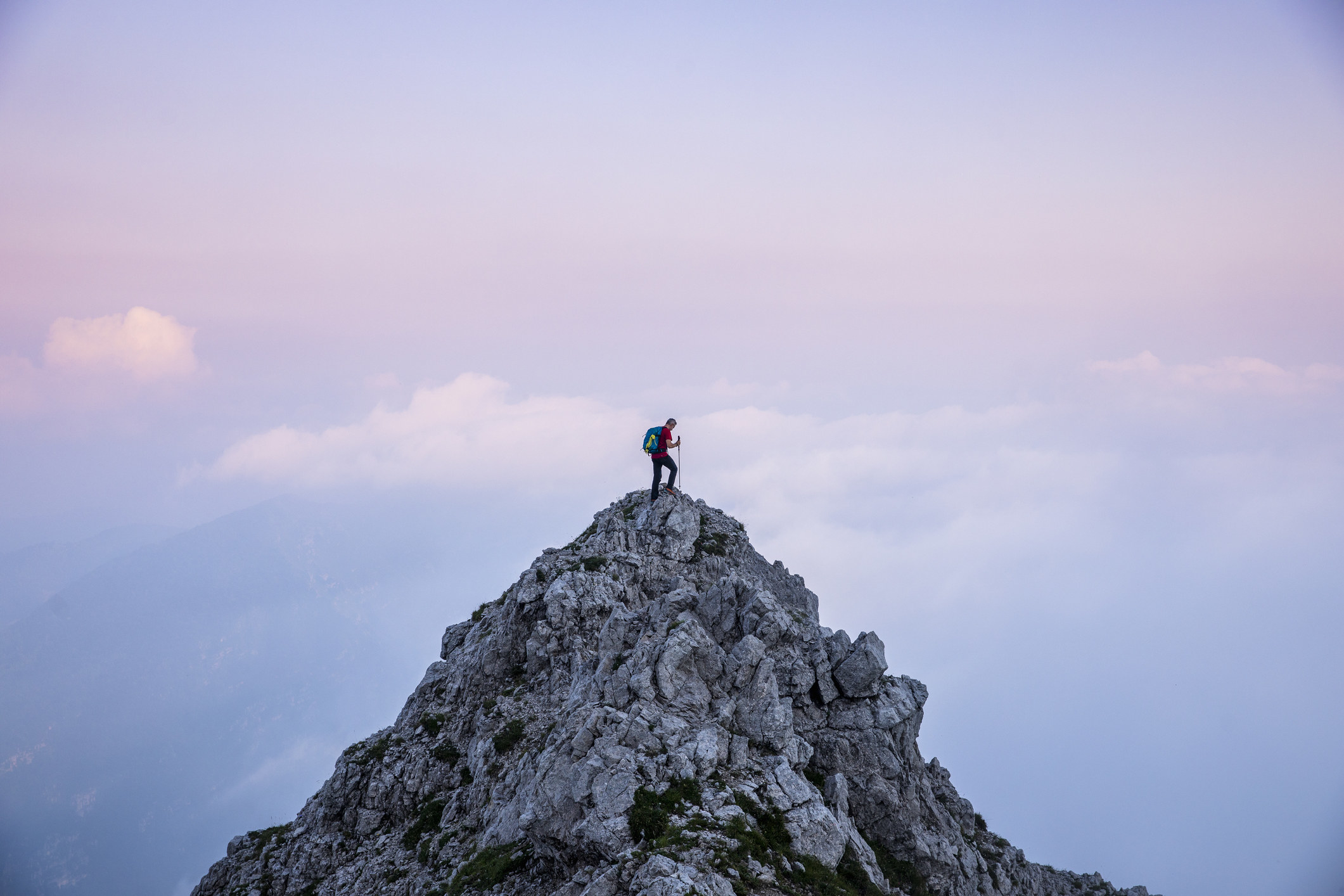 A hiker at the top of a mountain
