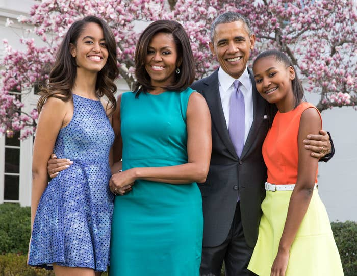 The Obama family poses for a photo outside the White House