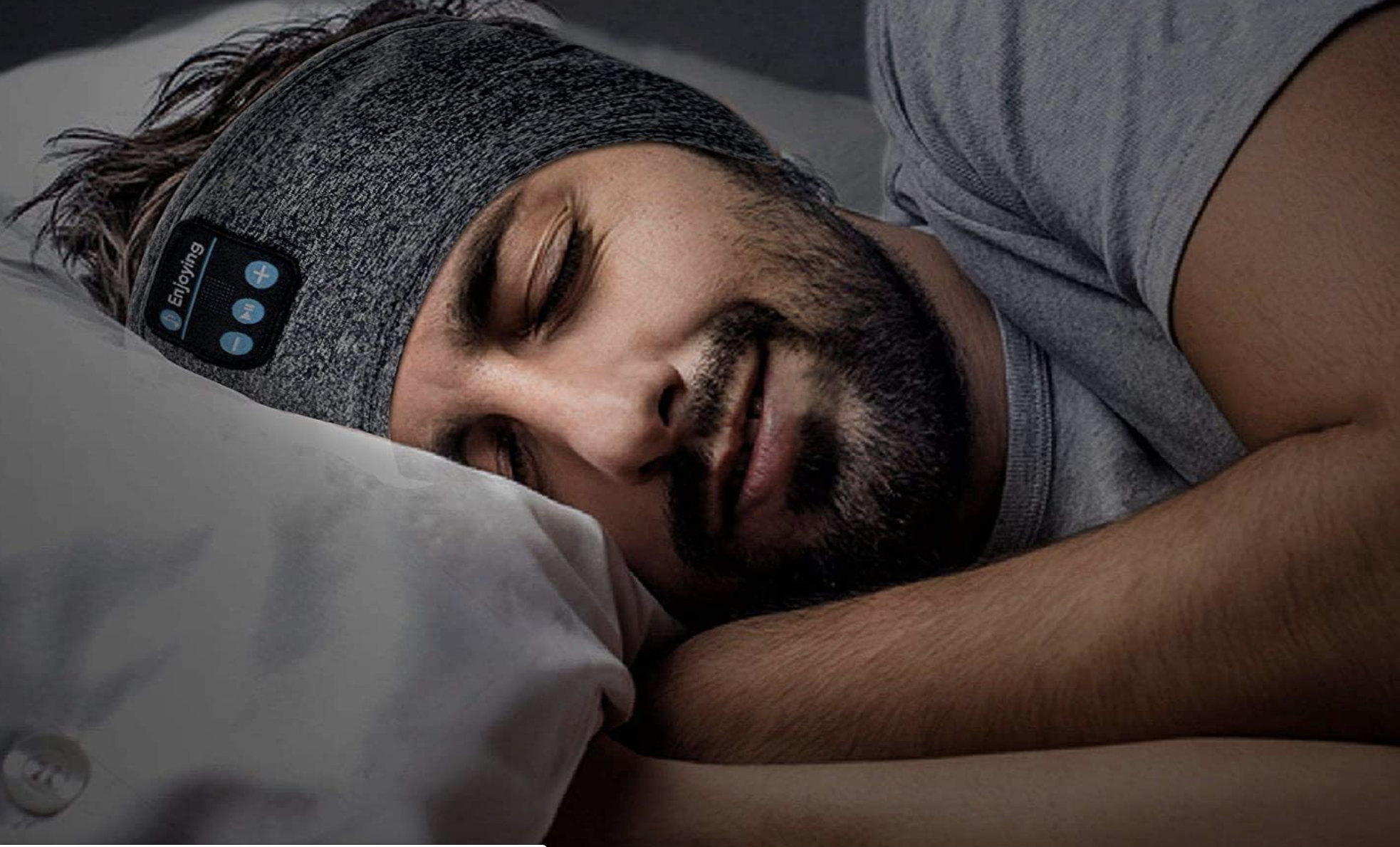 A model sleeping with the headphone band around their ears